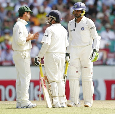 Ricky Ponting in discussion with Sachin Tendulkar and Harbhajan