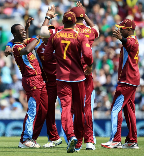 Kemar Roach of the West Indies celebrates