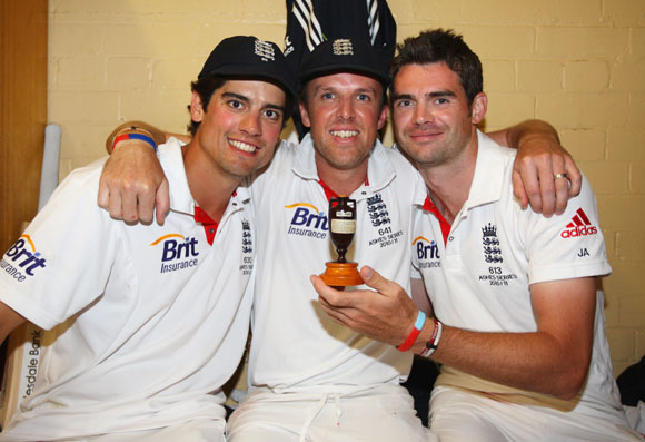 Alastair Cook, Graeme Swann and James Anderson of England celebrate in the dressing room with the ashes urn after winning the series 3-1