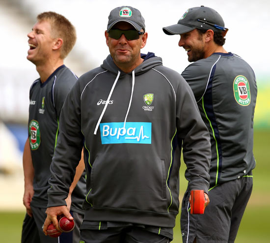 Australia coach Darren Lehmann (centre) with his players during a training session