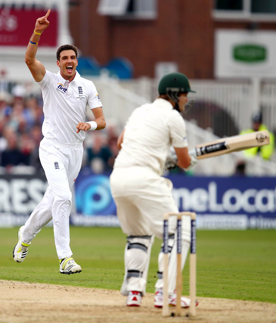 Steven Finn celebrates after taking the wicket of Shane Watson