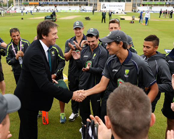Ashton Agar receives his Baggy Green cap on his Test debut from former Australian fast bowler Glenn McGrath
