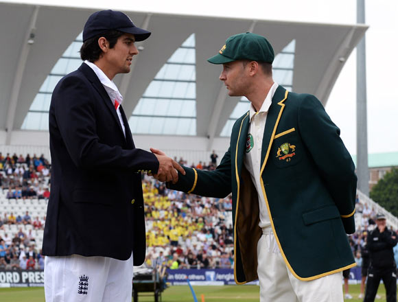 England captain Alastair Cook (left) shakes hands with his Australian counterpart Michael Clarke