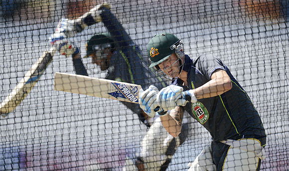 Australia's captain Michael Clarke (right) plays a shot during a training session on Tuesday, on the eve of the first Ashes Test against England at Trent Bridge cricket ground in Nottingham, England