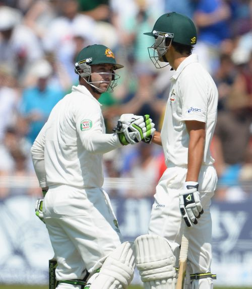 Phil Hughes (L) and Ashton Agar of Australia shake hands after both reaching half centuries during day two of the 1st Investec Ashes Test match between England and Australia at Trent Bridge Cricket Ground