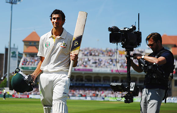 Ashton Agar of Australia acknowledges the crowd after being dismissed by Stuart Broad of England for 98 runs