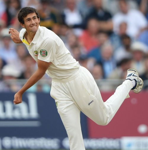 Ashton Agar (R) of Australia celebrates his half century with Phil Hughes