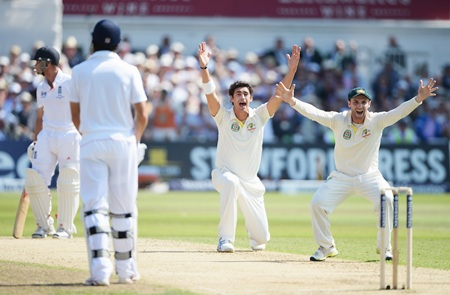 Mitchell Starc appeals successfully for the wicket of Jonathan Trott after a referral. Phil Hughes is on the right.