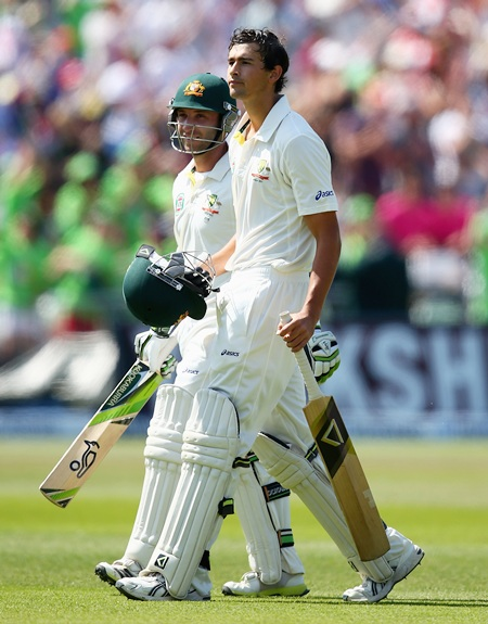 Ashton Agar and Phil Hughes leave the ground after their record 10th wicket partnership