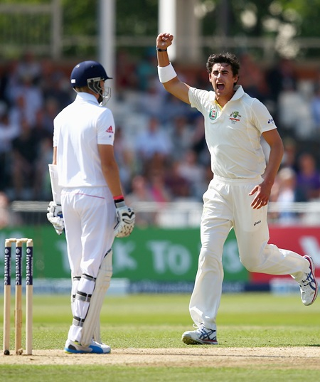 Mitchell Starc celebrates after taking the wicket of Joe Root in England's second innings