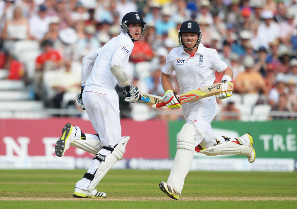 Stuart Broad (left) and Ian Bell of England run between the wickets