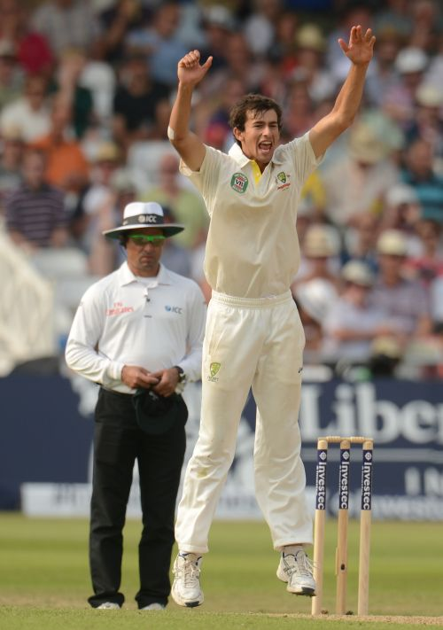 Australia's Ashton Agar celebrates after England's Stuart Broad edged the ball to Michael Clarke but umpire Aleem Dar gave it not out during the first Ashes cricket test match at Trent Bridge cricket ground in Nottingham