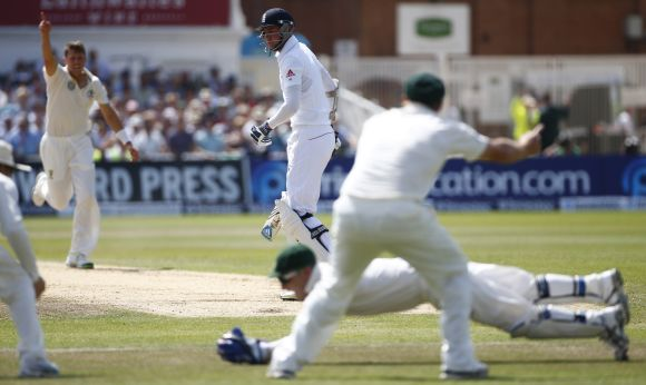 England's Stuart Broad (centre) is caught out by Australia's Brad Haddin during the fourth day