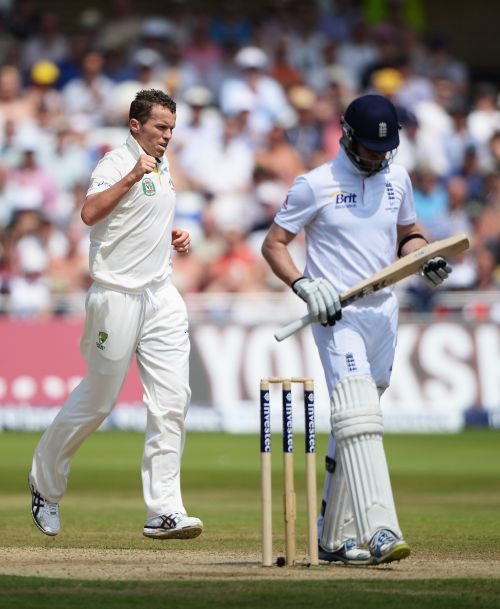 Peter Siddle of Australia celebrates taking the wicket of Graeme Swann of England