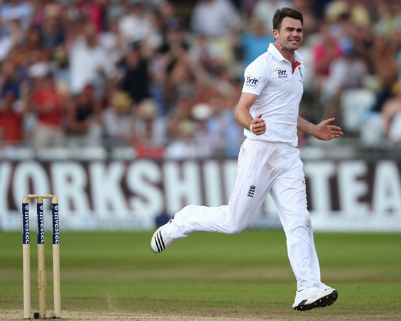 James Anderson of England celebrates the wicket of Chris Rogers of Australia