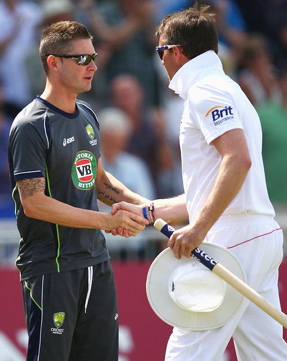 Michael Clarke of Australia congratulates Graeme Swann of England