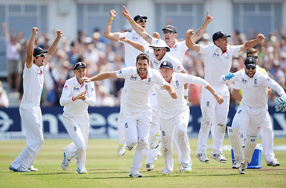 England players celebrate on winning the 1st Ashes Test following the wicket of Brad Haddin at Trent Bridge on Sunday