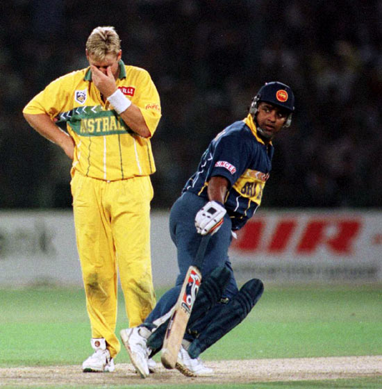 Shane Warne (left) reacts as Arjuna Ranatunga takes a run