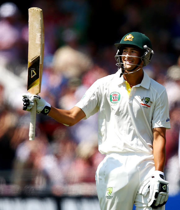 Ashton Agar celebrates after reaching his half-century