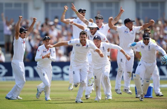 James Anderson of England celebrates the final wicket of Brad Haddin of Australia and victory with team mates during day five of the 1st Investec Ashes Test match between England and Australia at Trent Bridge Cricket Ground