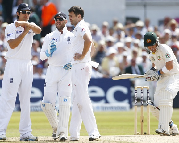 England's captain Alastair Cook signals for a television rev