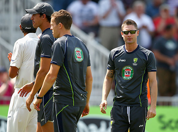 Michael Clarke of Australia with teammates