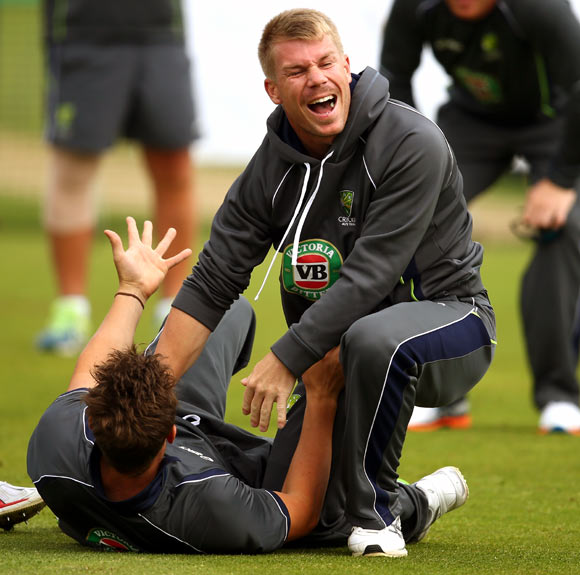 David Warner jokes with a team-mate during an Australian training session.