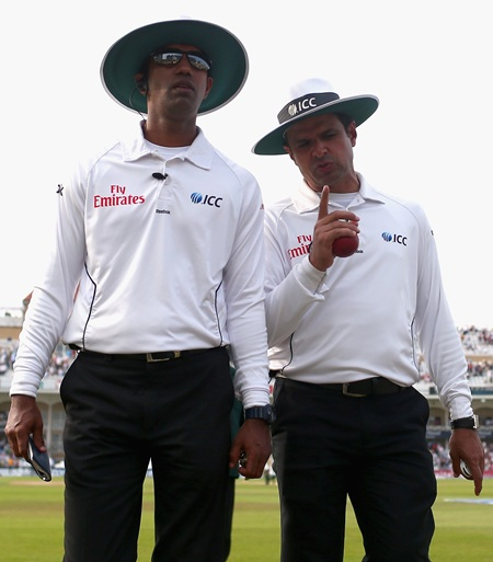 Umpires Kumar Dharmasena and Aleem Dar walk off the field at stumps on day three of the 1st Ashes Test at Trent Bridge