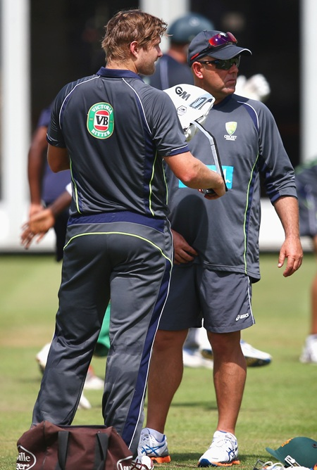 Shane Watson and coach Darren Lehmann talk during Australia's nets session at Lord's on Wednesday