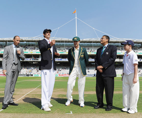 Alastair Cook of England tosses the coin with Australian captain Michael Clarke, commentator Nasser Hussain (left) and match referee Ranjan Madugalle during day one of the 2nd Ashes Test at Lord's