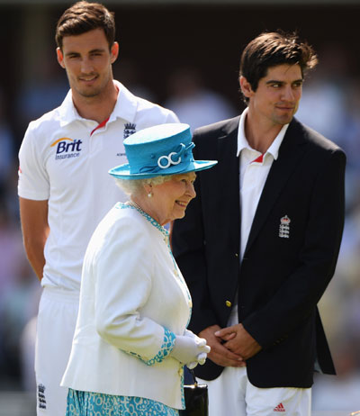 Queen Elizabeth II smiles after meeting England captain Alastair Cook (right) and Steven Finn prior to day one of the second Ashes Test