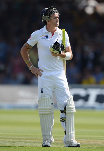 Kevin Pietersen of England looks dejected after being dismissed by Ryan Harris of Australia