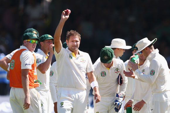 Ryan Harris of Australia celebrates after taking his fifth wicket
