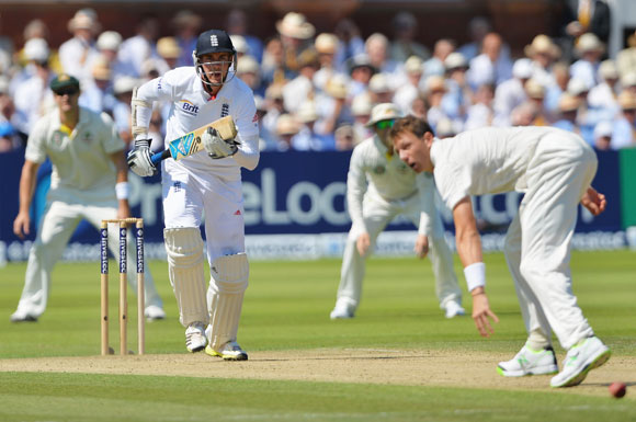 Stuart Broad hits the ball past Australia bowler James Pattinson