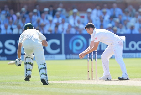 James Anderson of England celebrates the run out of Ashton Agar