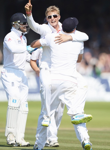 Joe Root celebrates the wicket of Usman Khawaja