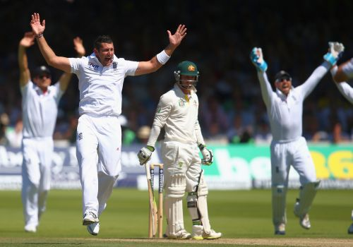 Tim Bresnan of England celebrates after taking the wicket of Phil Hughes of Australia