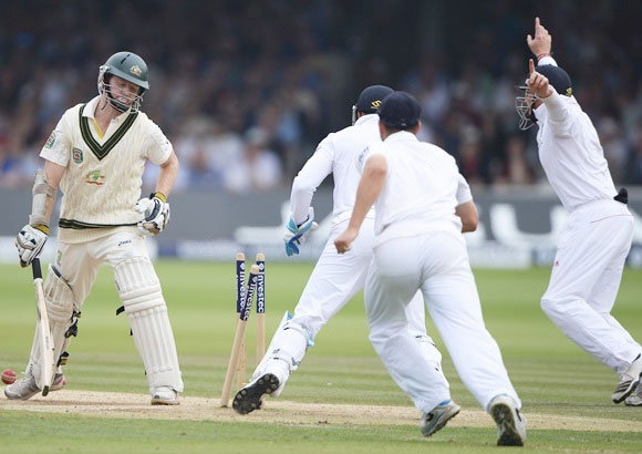 Australia's Chris Rogers is bowled by Graeme Swann during the 2nd Test at Lord's