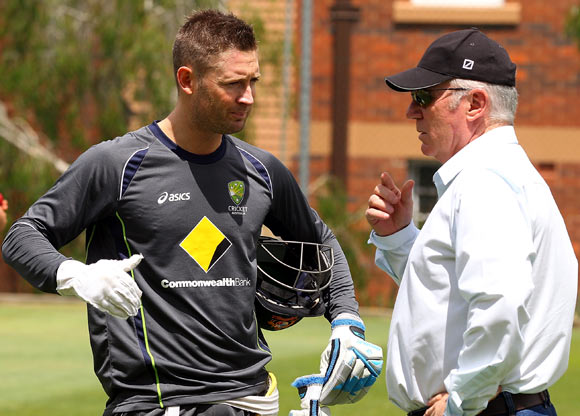 Michael Clarke (left) speaks to Allan Border