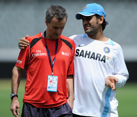 India captain Mahendra Singh Dhoni speaks with umpire Billy Bowden
