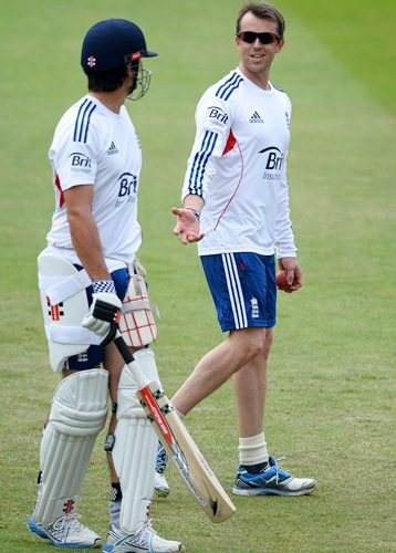 Graeme Swann of England shares a joke with Alastair Cook