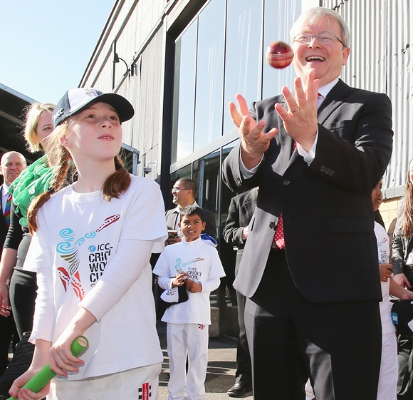 Australian Prime Minister Kevin Rudd catches a cricket ball