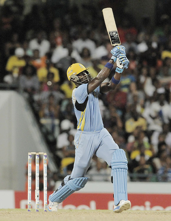 Darren Sammy of St. Lucia Zouks hits a 6 against Barbados Tridents at Kensington Oval in Bridgetown, Barbados, on Tuesday