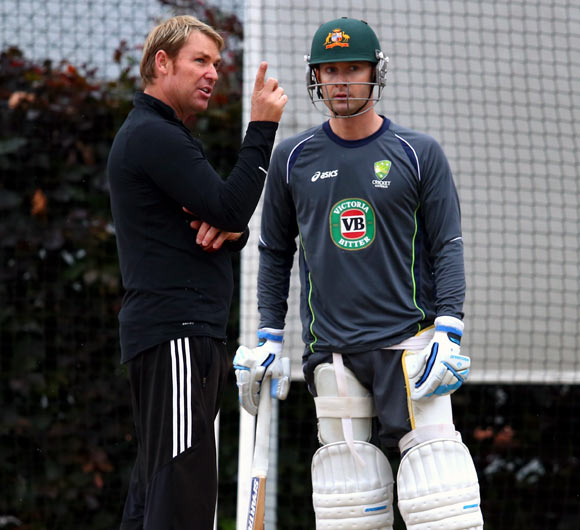 Shane Warne (left) speaks to Michael Clarke