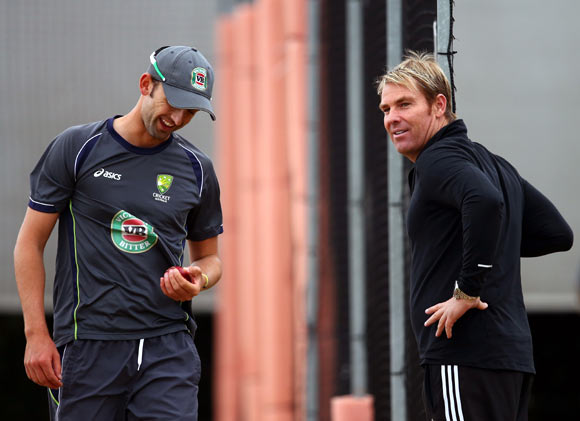 Nathan Lyon (left) with Shane Warne during the Australian nets session in Manchester.