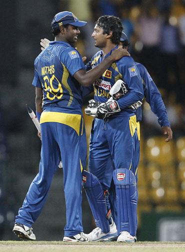 Angelo Mathews and Kumar Sangakkara celebrate the win