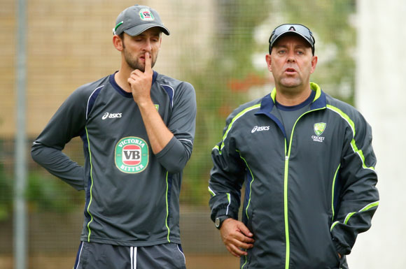 Nathan Lyon of Australia and Darren Lehmann, coach of Australia look on during a training Session at The County Ground in Brighton