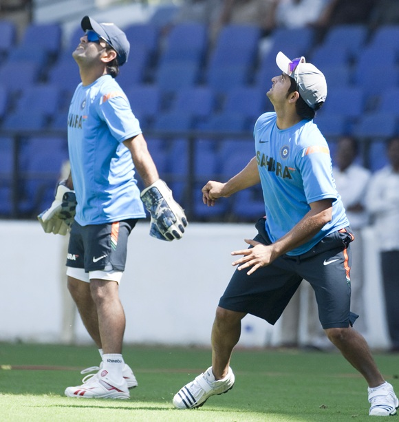 Indian captain MS Dhoni and Suresh Rainia during a practise session