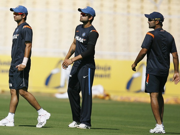 From left: Suresh Raina, Virat Kohli and Dinesh Karthik attend a practice session