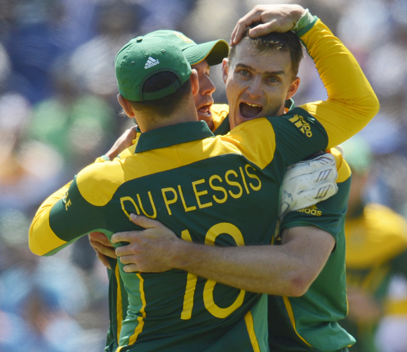 South Africa's Ryan McLaren (R) is congratulated after dismissing India's Dinesh Karthik